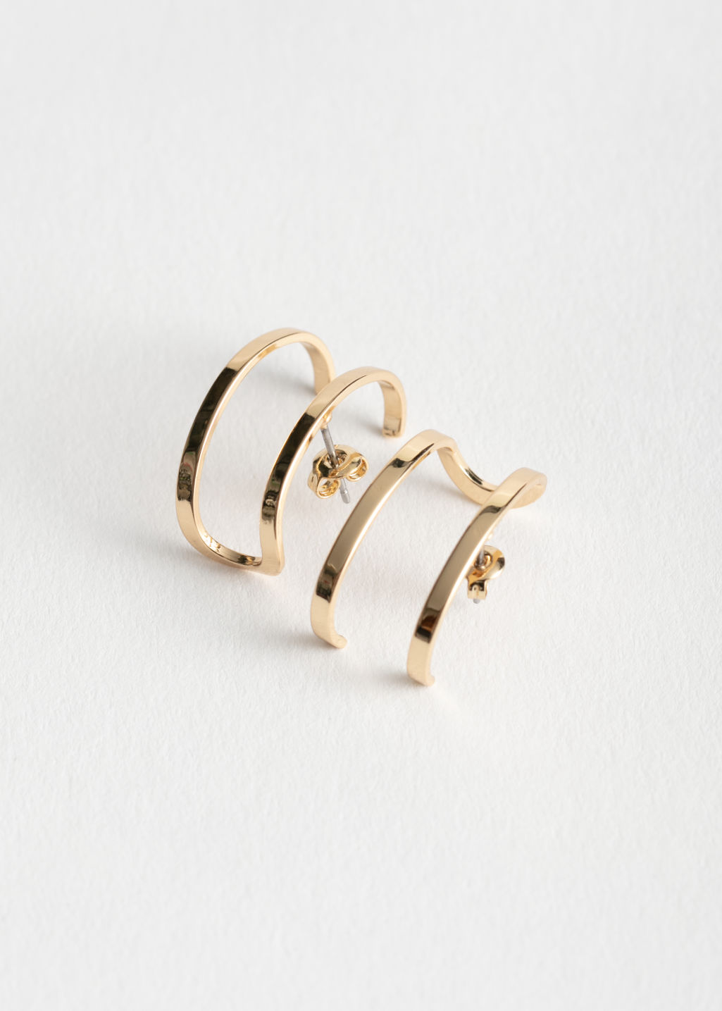 Front image of Stories double bar earrings in gold