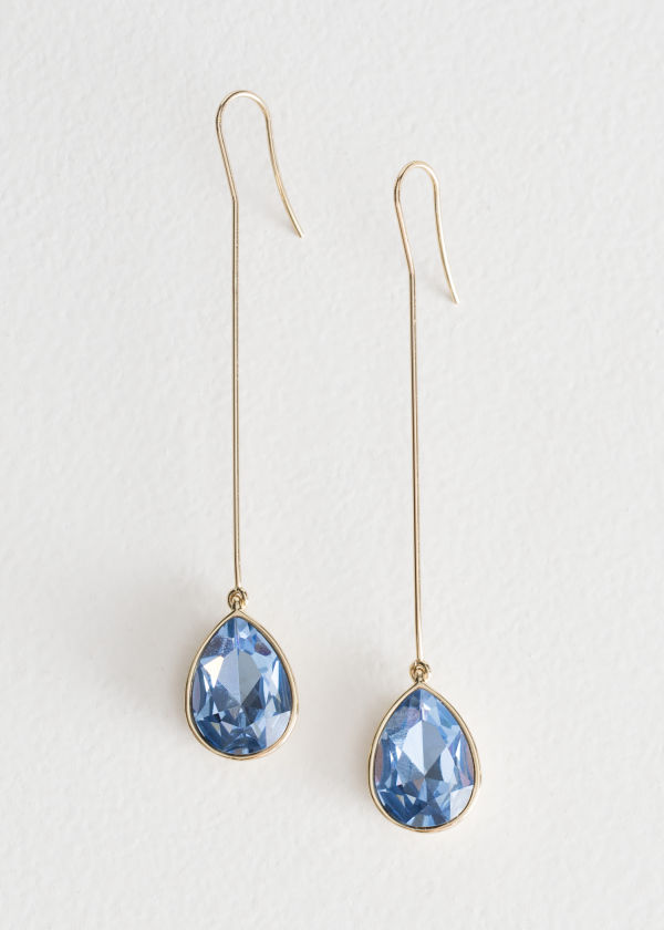 Front image of Stories pending crystal earrings in blue
