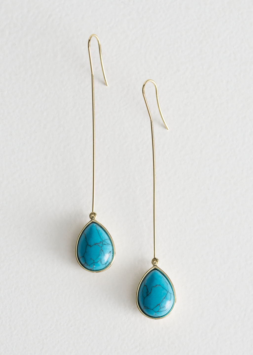 Front image of Stories pending crystal earrings in turquoise