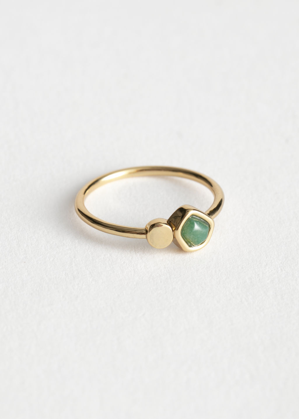 Front image of Stories stone and stud ring in green