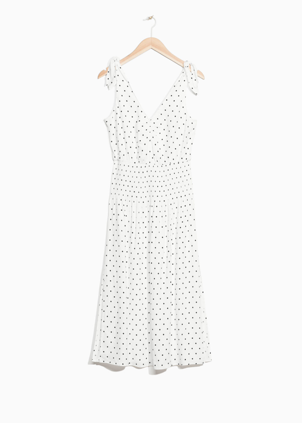 Front image of Stories dotted dress in white