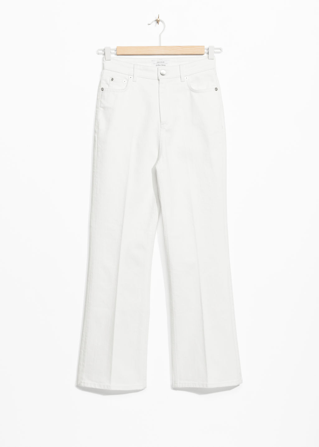 Front image of Stories cropped flared denim jeans in white