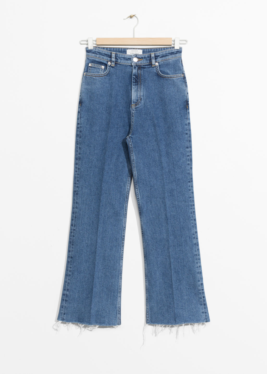 Front image of Stories cropped flared denim jeans in blue