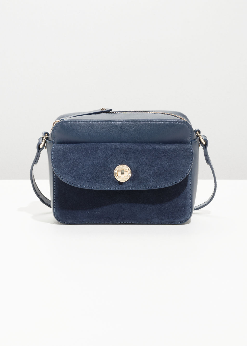 Front image of Stories mini leather shoulder bag in blue
