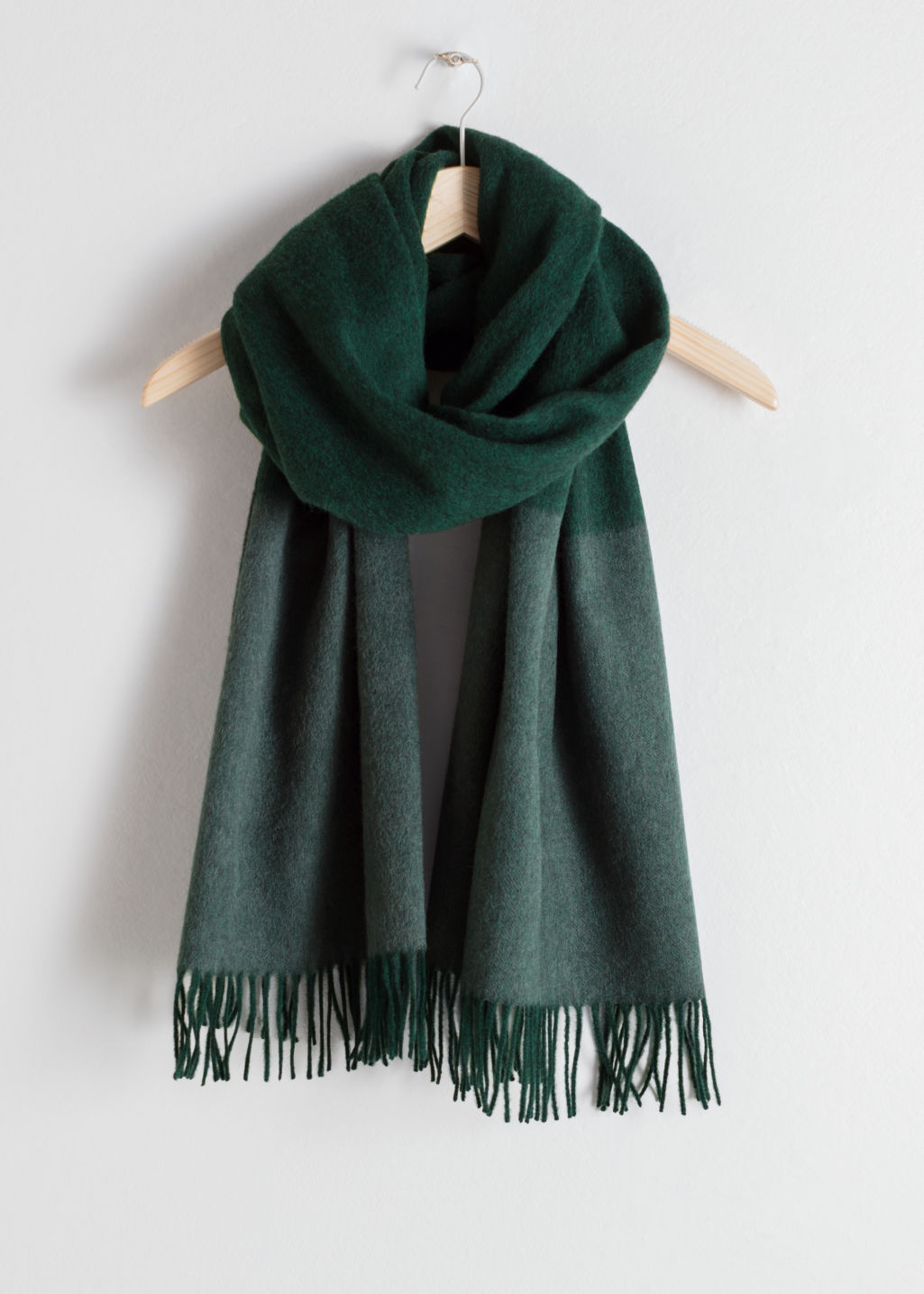 Front image of Stories oversized two toned wool scarf in turquoise