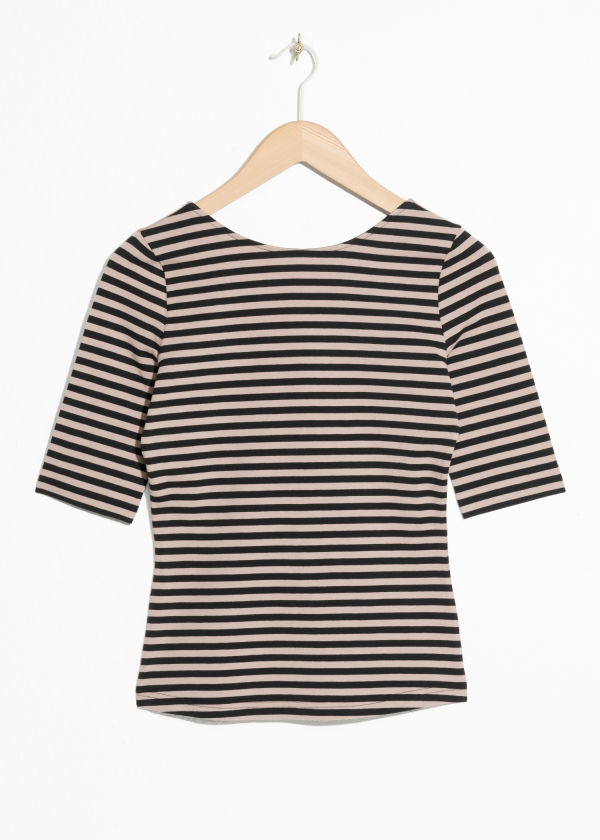 Front image of Stories striped top in black