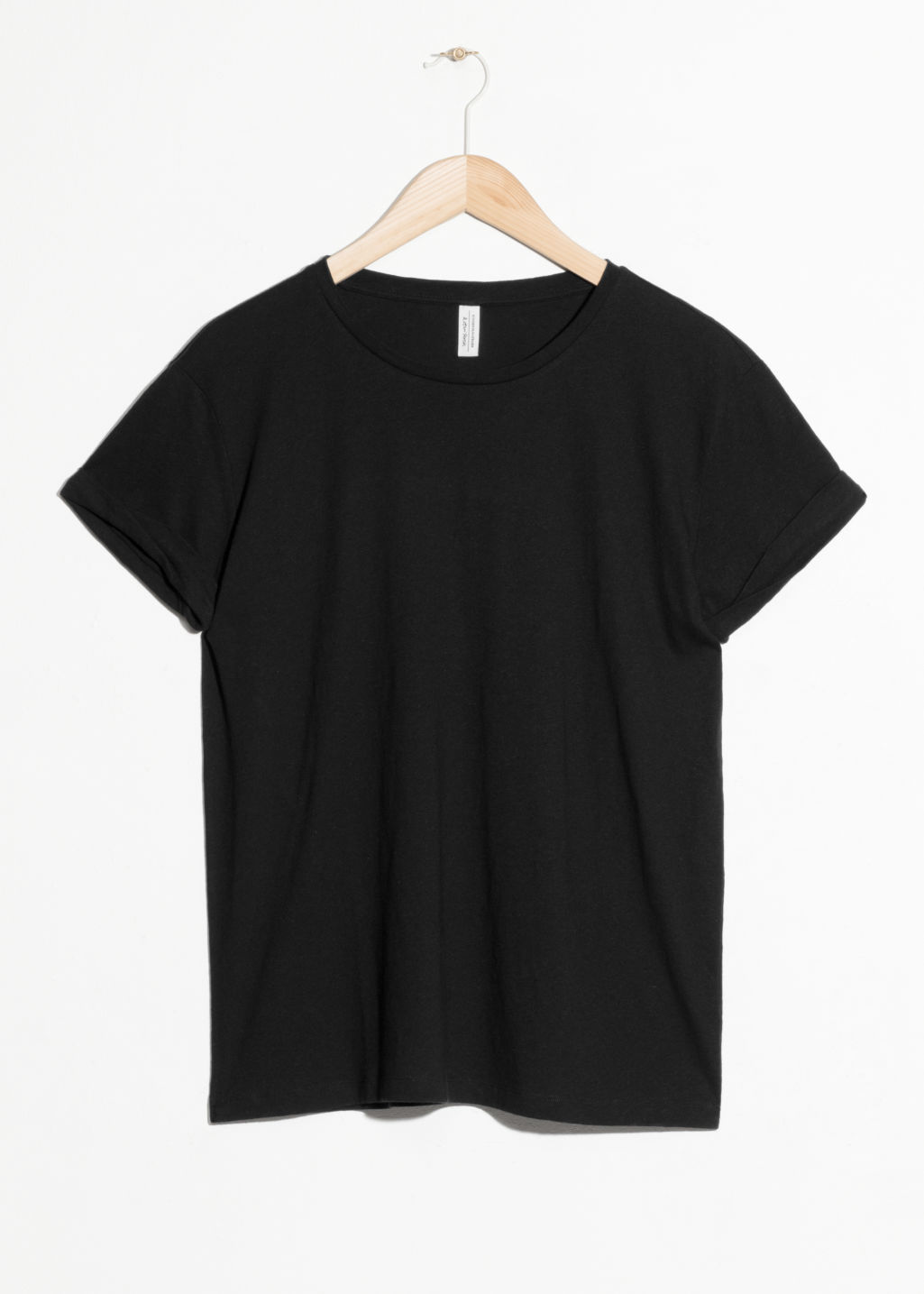 Front image of Stories cotton tee in black