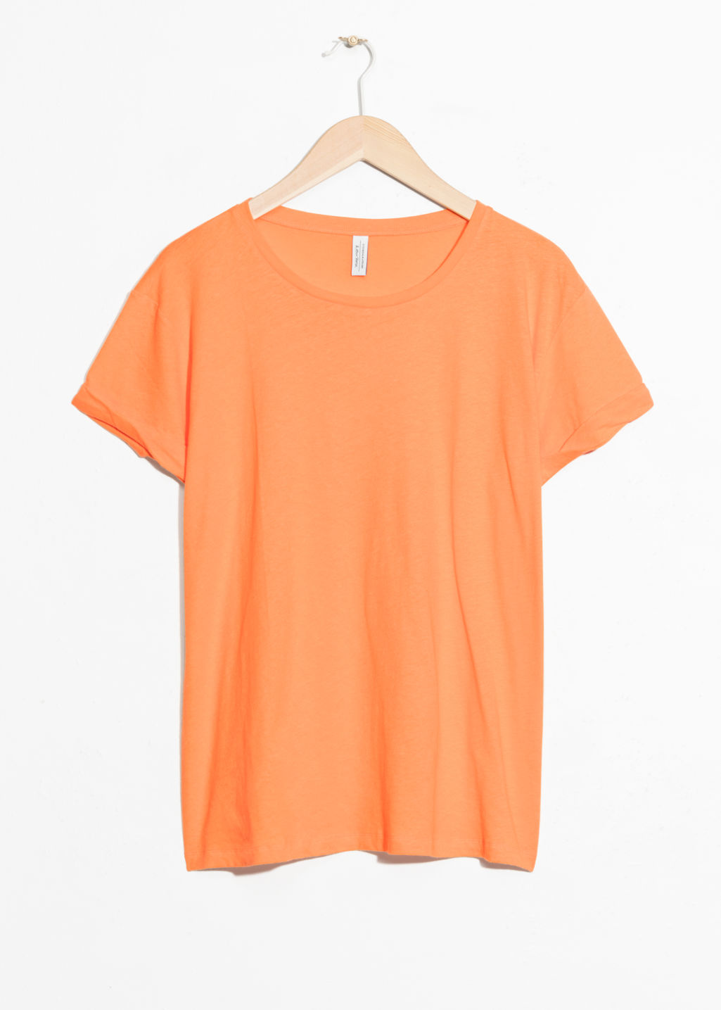 Front image of Stories cotton tee in orange
