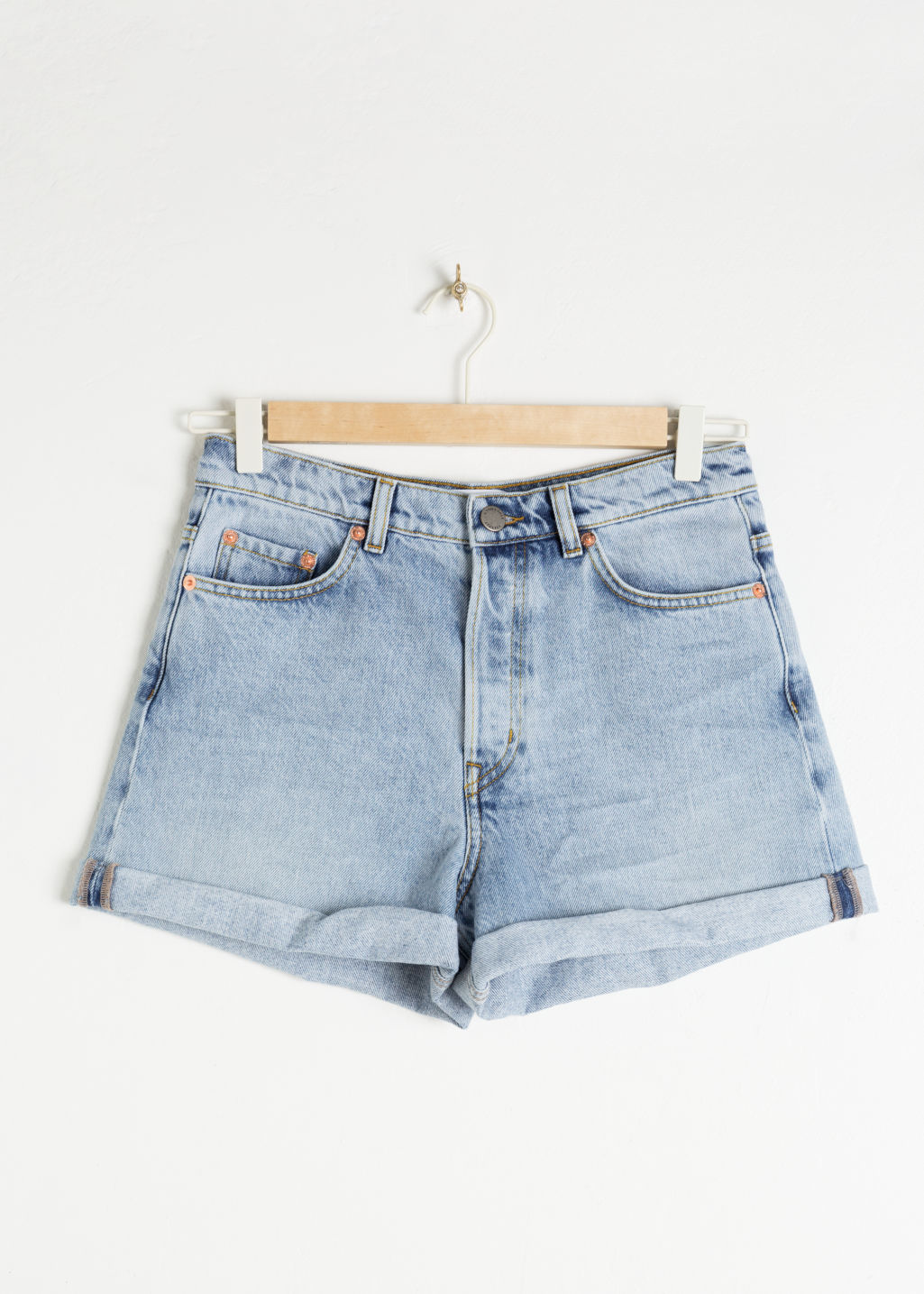 Front image of Stories denim mini shorts in blue