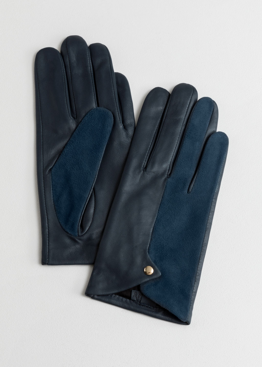 Front image of Stories leather gloves in blue