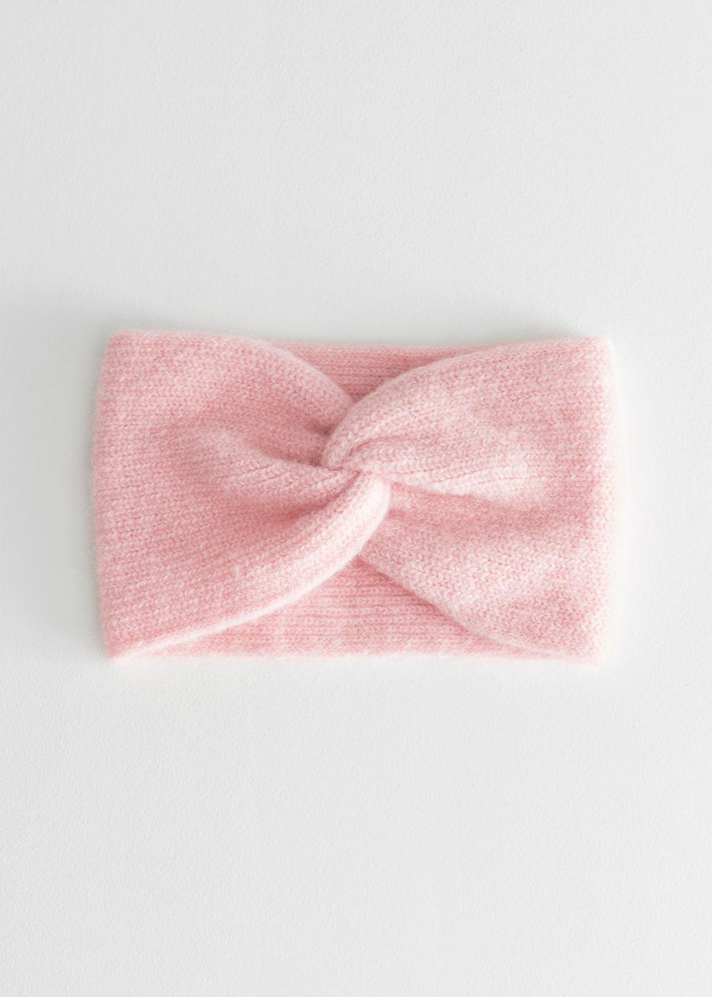 Front image of Stories twist headband in mohair blend in pink