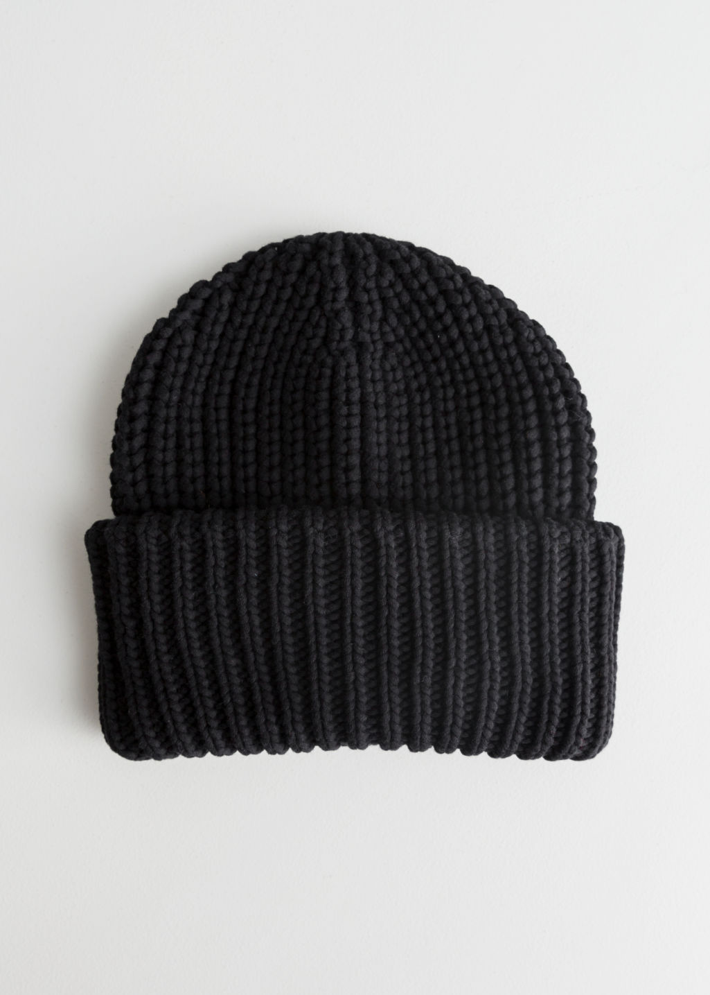 Front image of Stories rib knit beanie in black