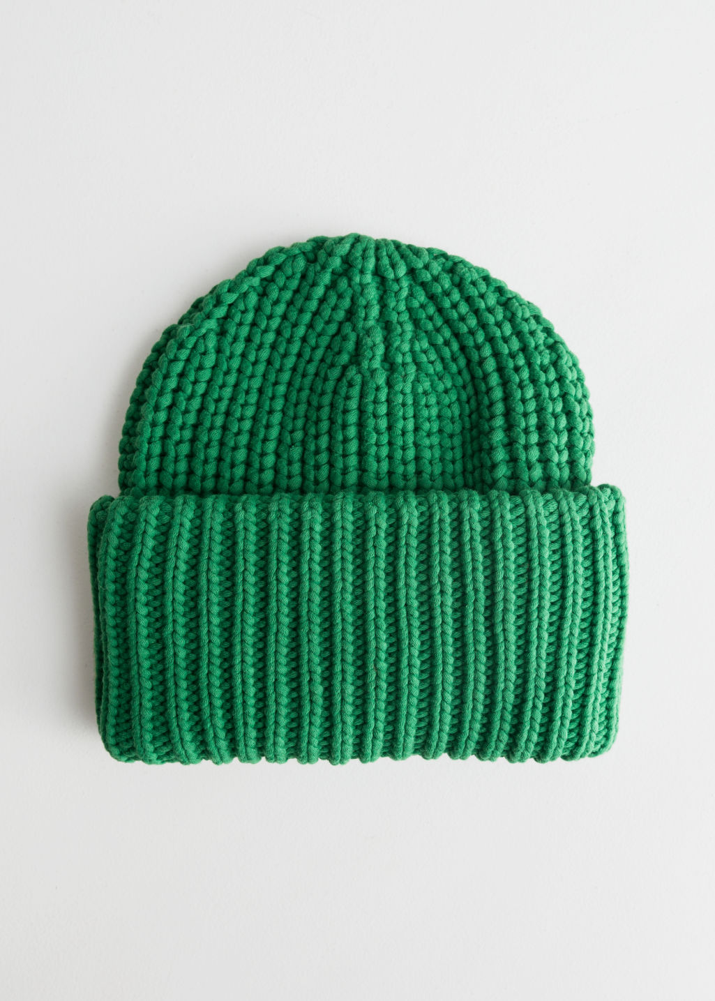 Front image of Stories rib knit beanie in green