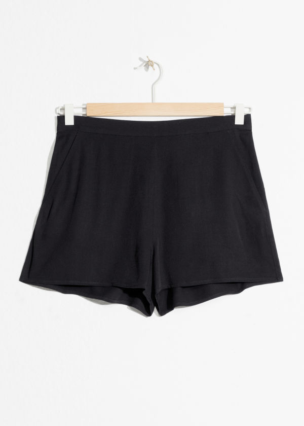 Front image of Stories tropical shorts in black