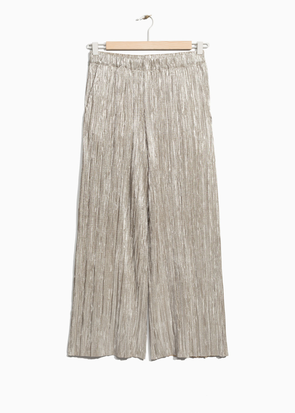 Front image of Stories pleated metallic trousers in gold