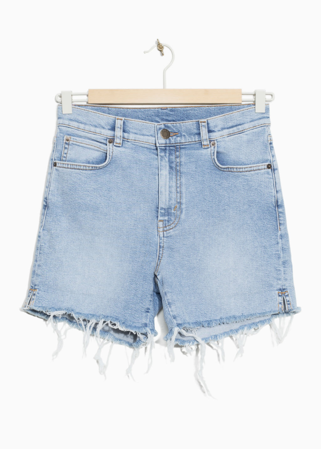 Front image of Stories raw hem denim shorts in blue