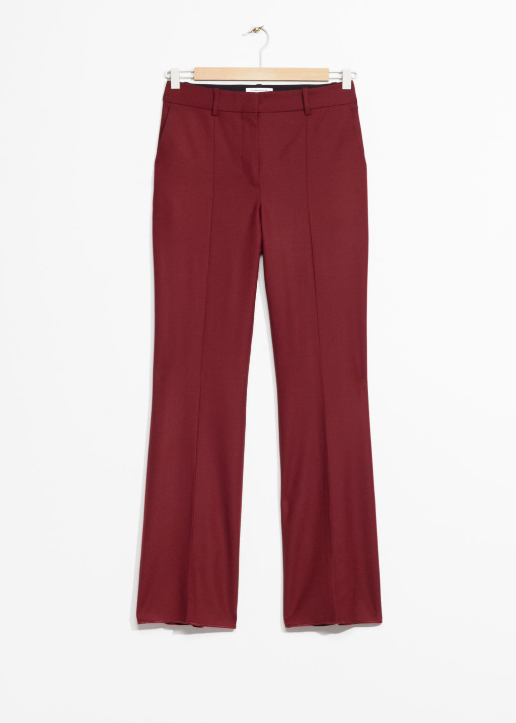 Front image of Stories crease wool trousers in red
