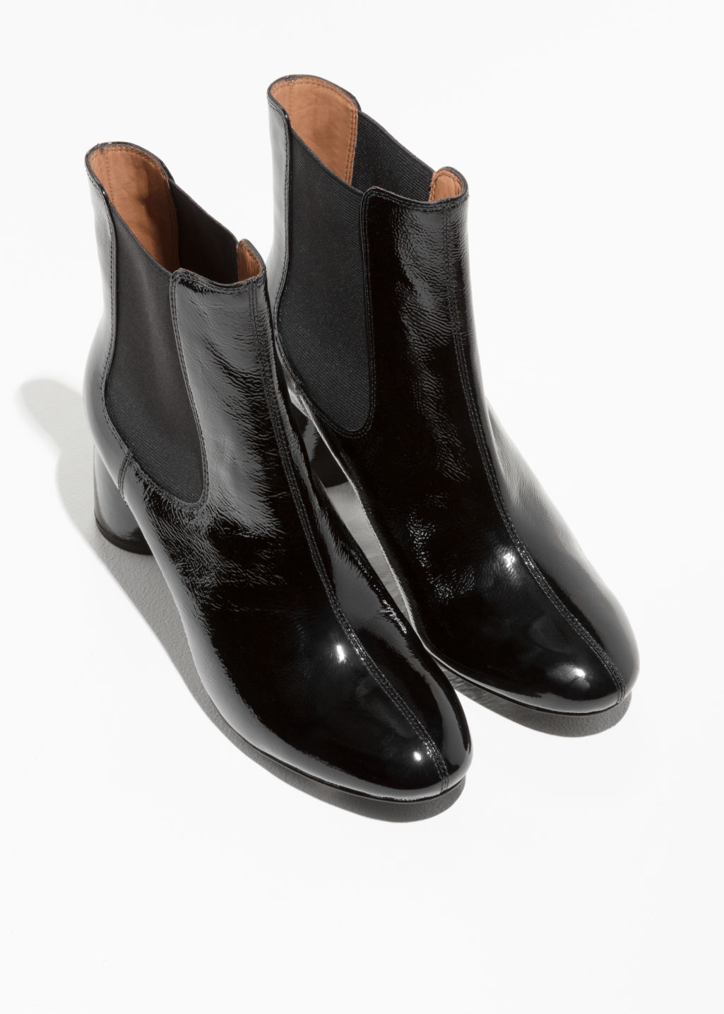 Back image of Stories patent leather boots in black