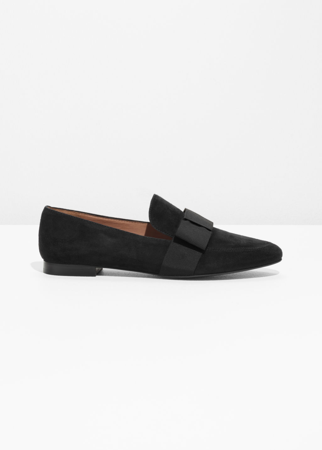Front image of Stories suede loafers in black