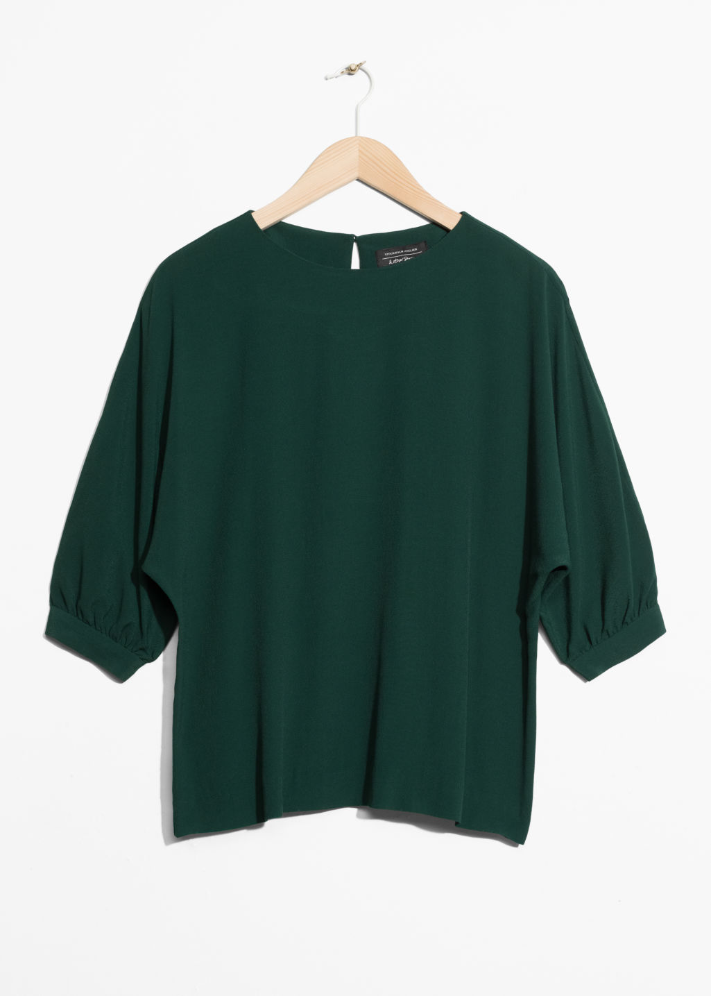 Front image of Stories puff sleeve blouse in green