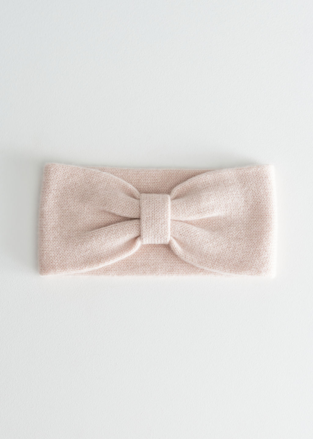 Front image of Stories cashmere bow headband in orange