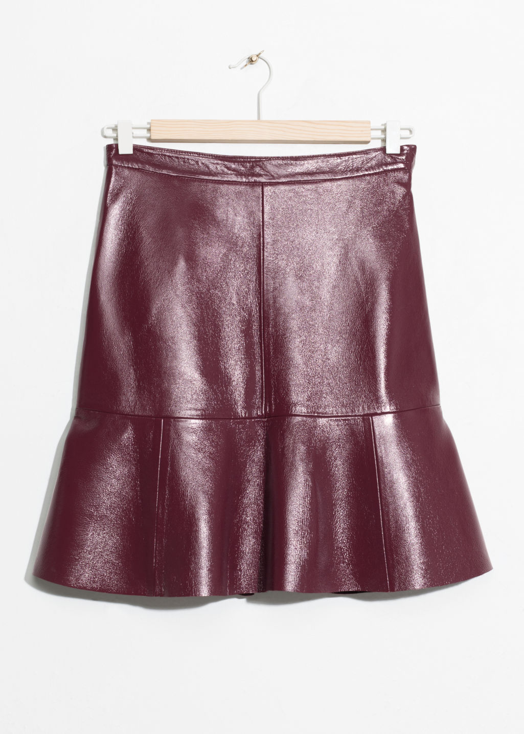 Front image of Stories frill leather skirt in red