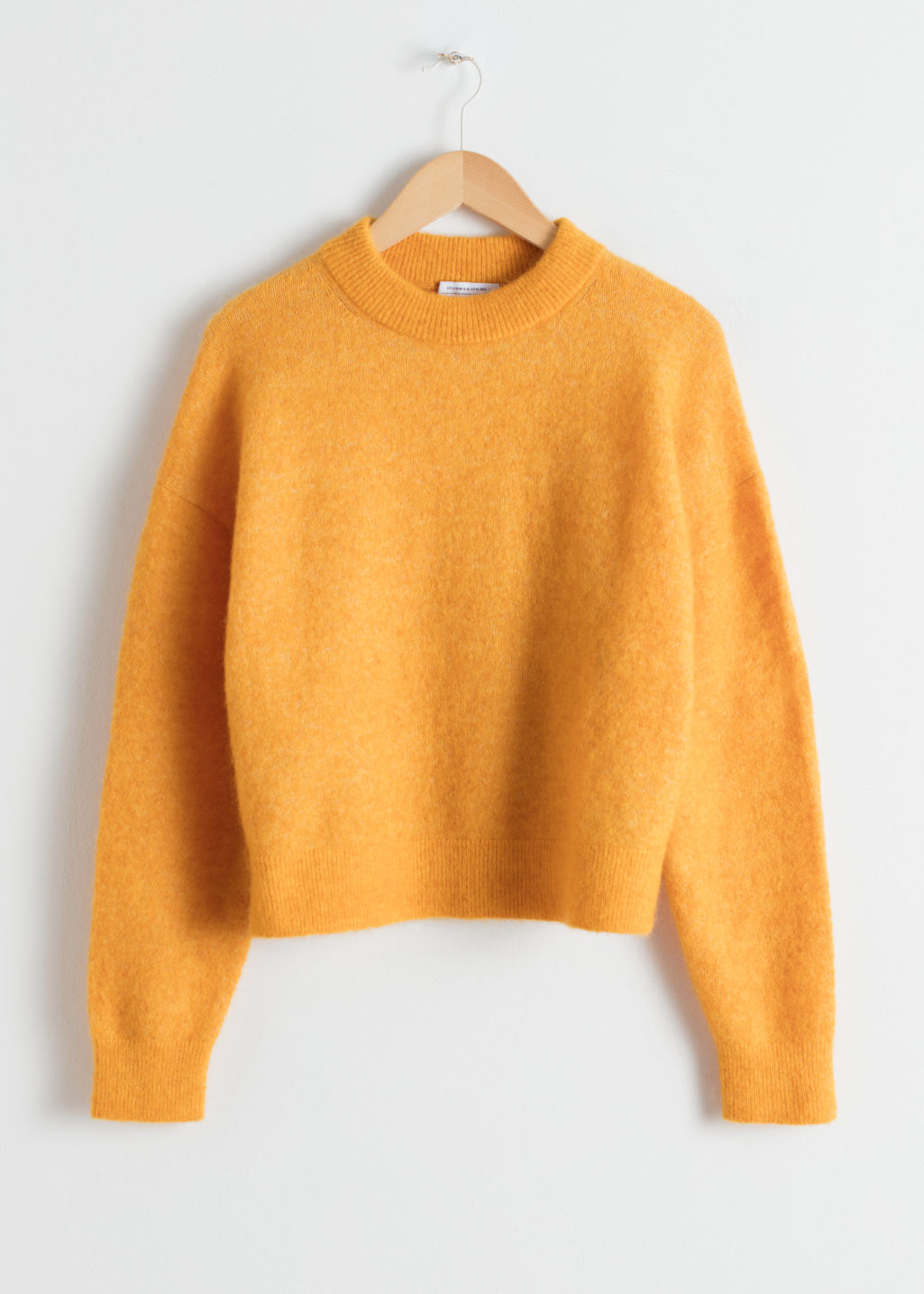 Front image of Stories wool blend fuzzy sweater in yellow