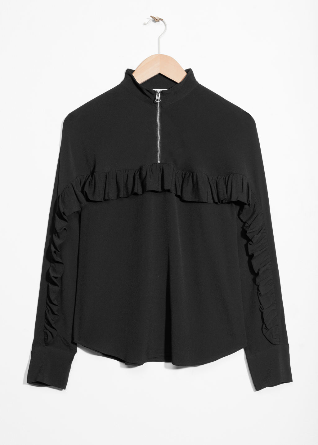 Front image of Stories frill zip blouse in black