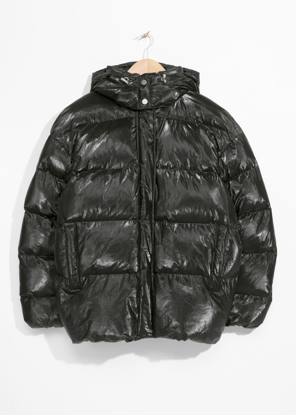 Front image of Stories padded down puffer jacket in black