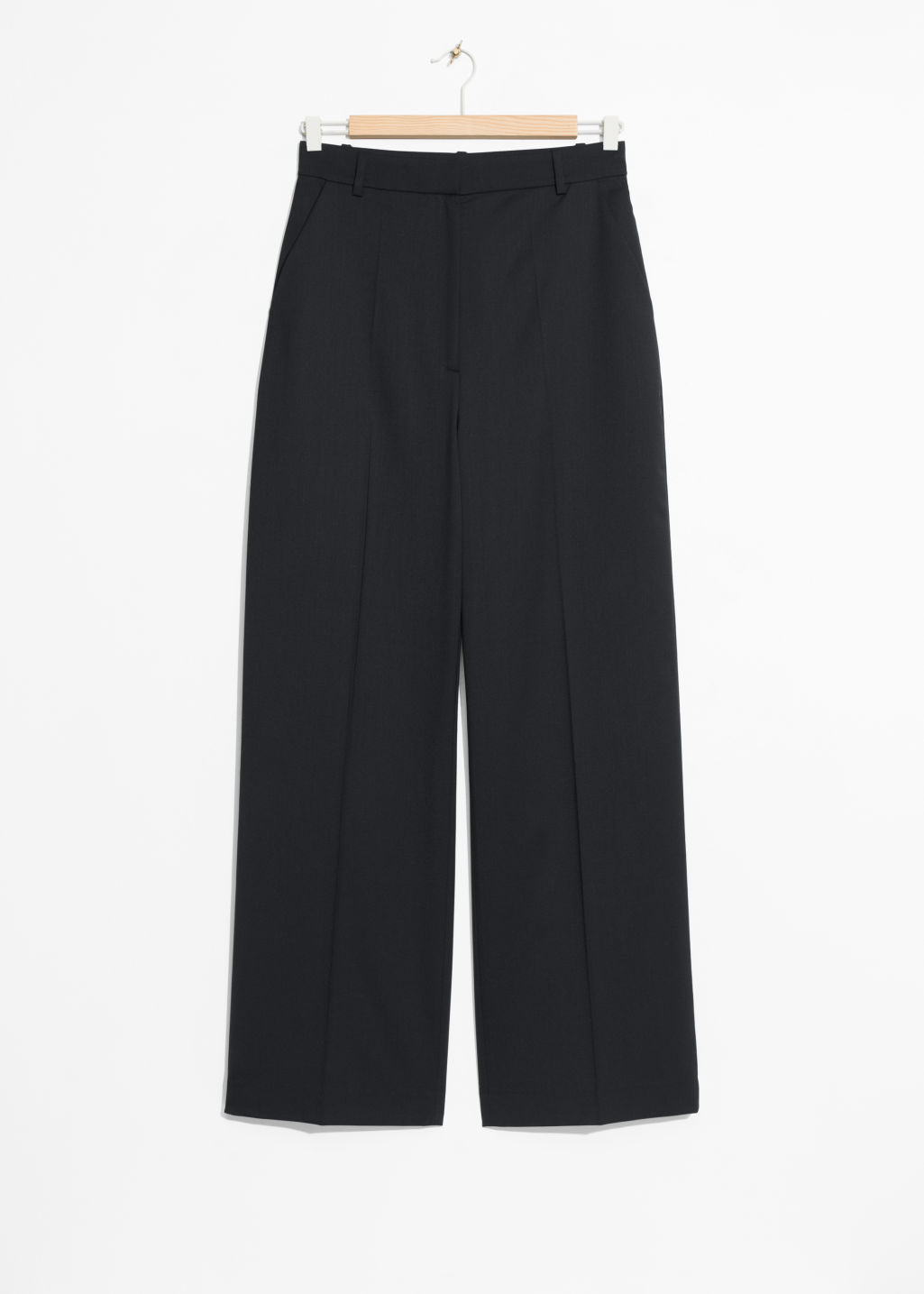 Front image of Stories wide leg wool trousers in black