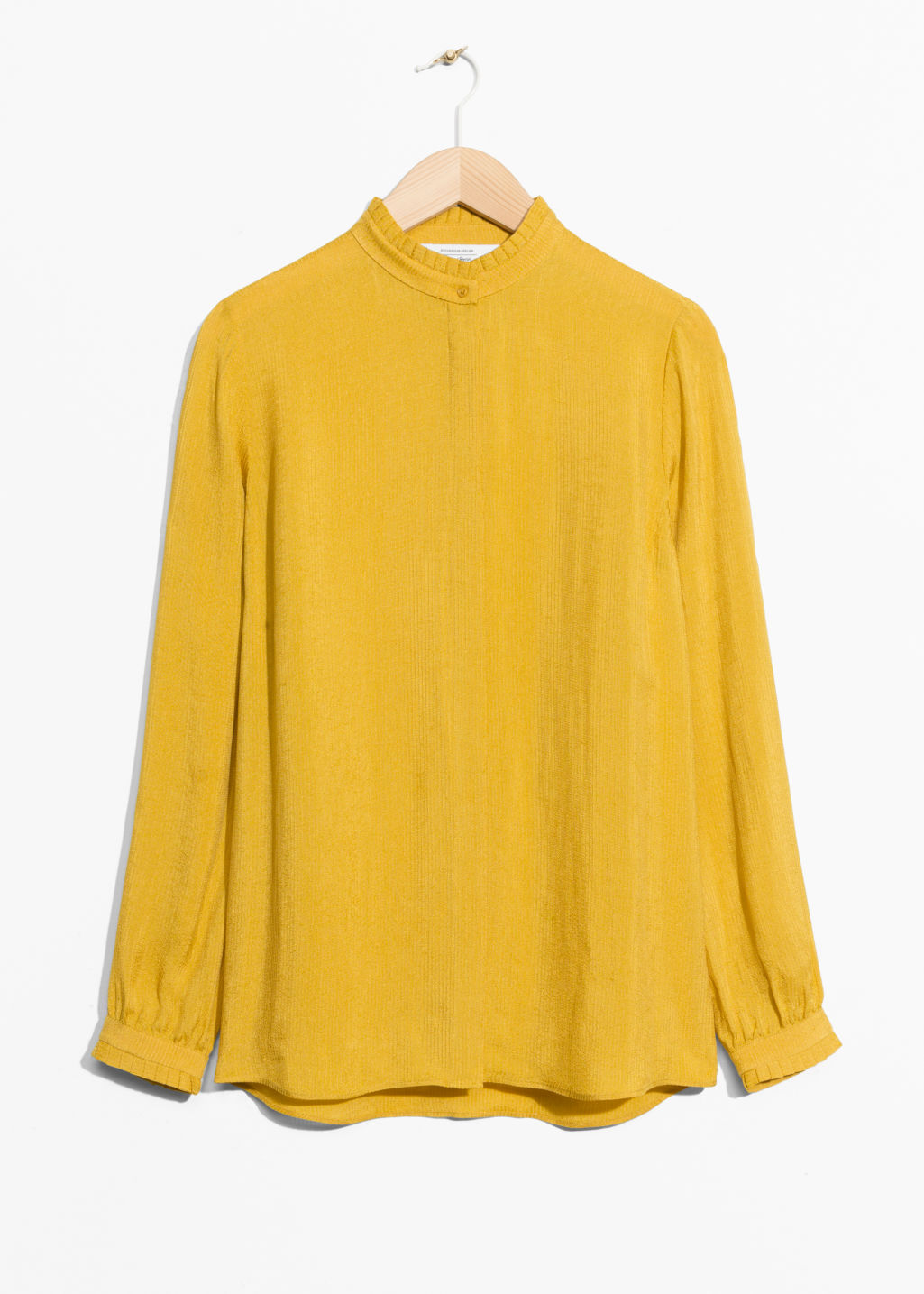 Front image of Stories pleat frill neck blouse in yellow
