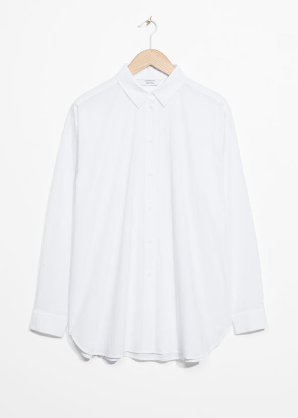 Front image of Stories relaxed fit cotton button-down in white