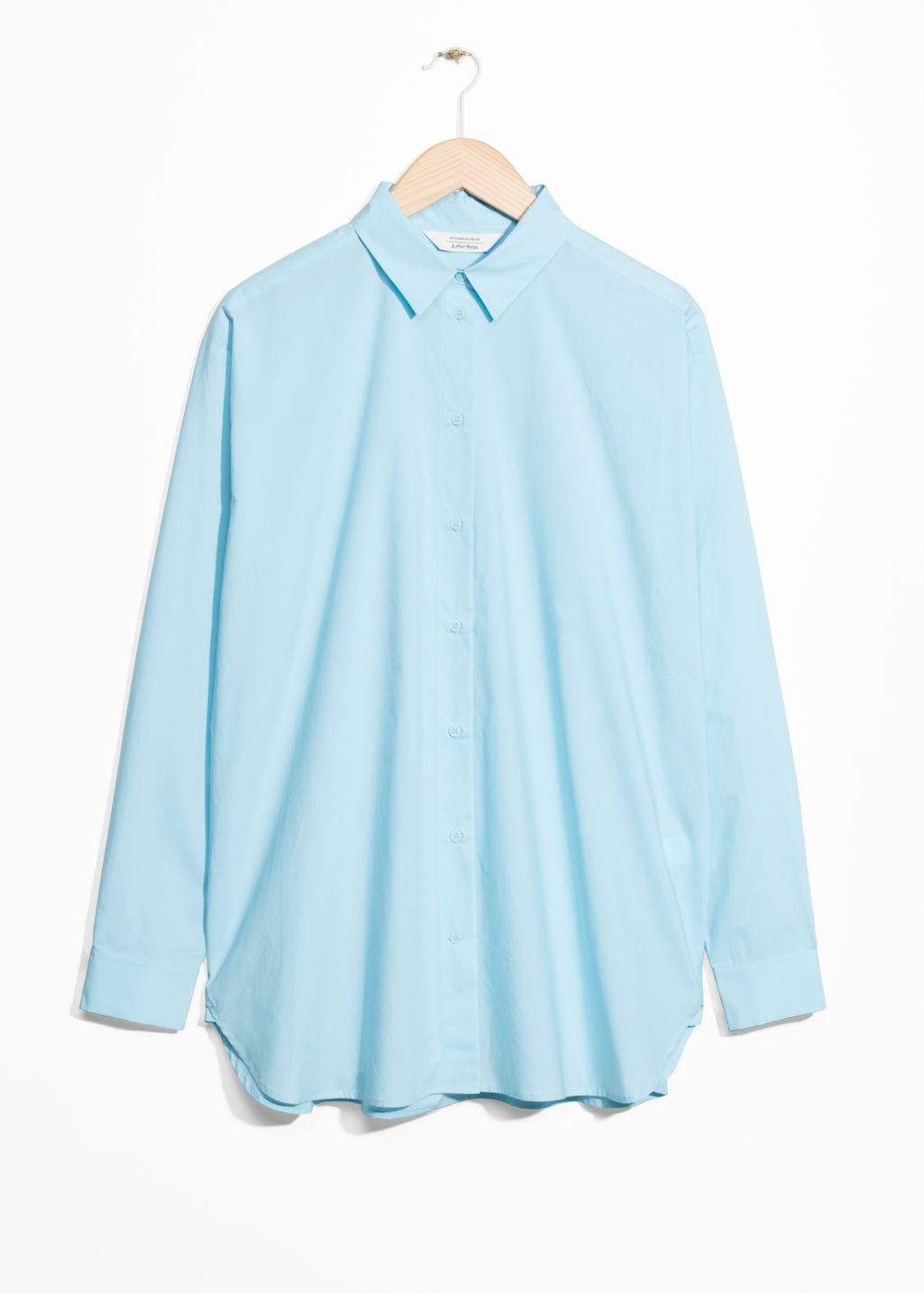 Front image of Stories relaxed fit cotton button-down in turquoise