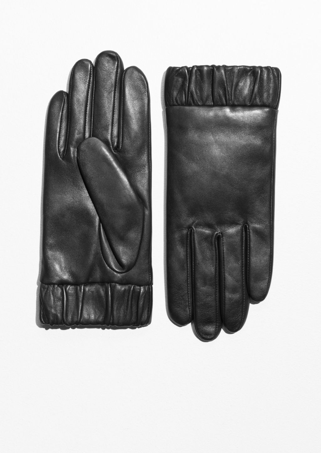 Front image of Stories elastic cuff leather gloves in black