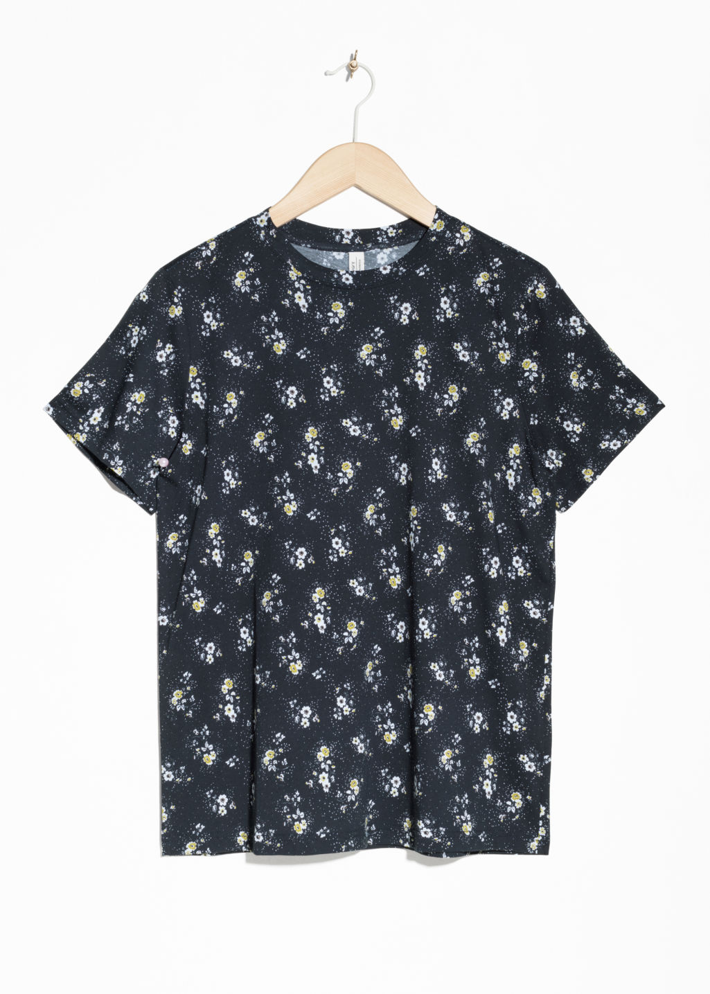Front image of Stories floral cotton top in black