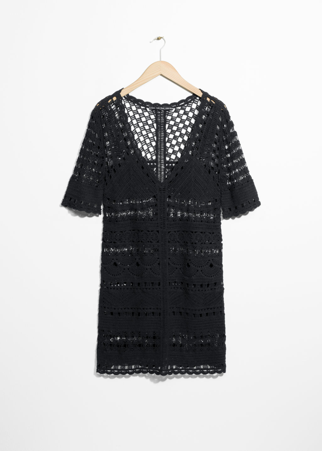 Front image of Stories crochet dress in black