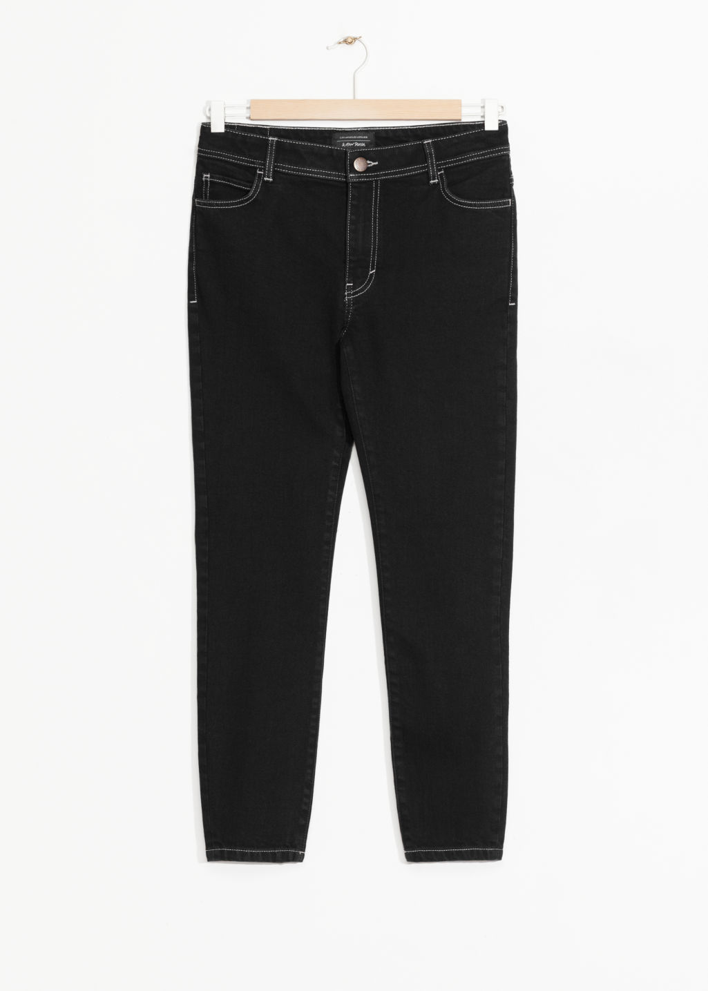 Front image of Stories cropped denim jeans in black