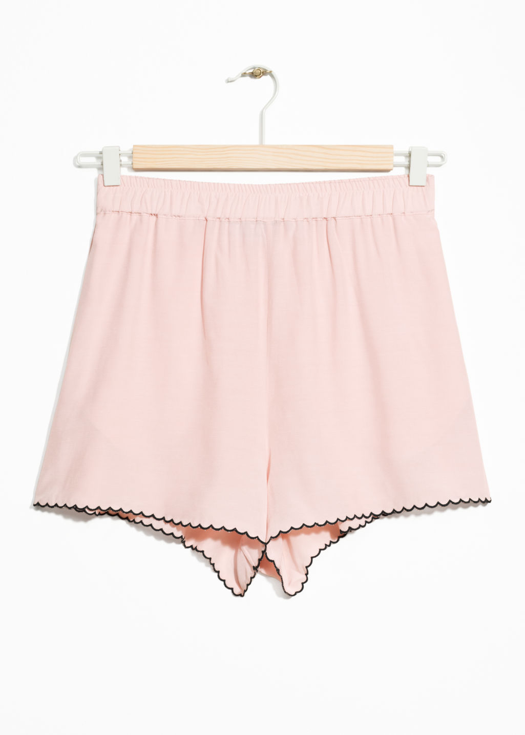 Front image of Stories scallop edge shorts in orange