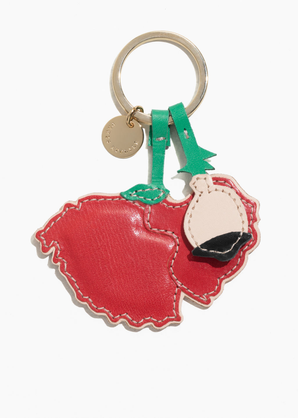 Front image of Stories leather poppy keyring in red