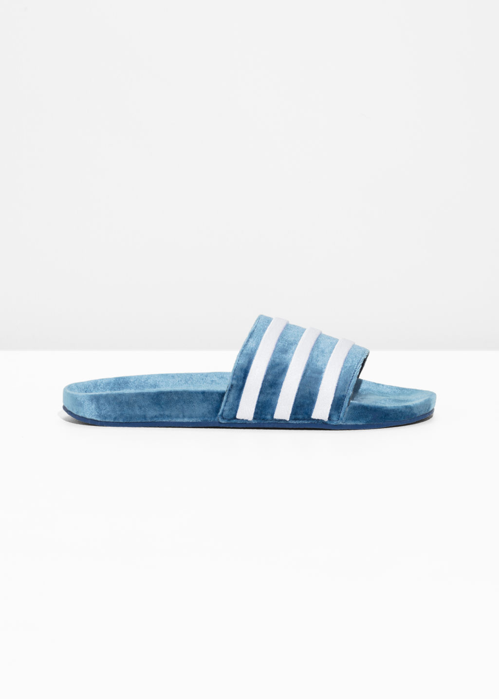 Front image of Stories adidas adilette slides in blue