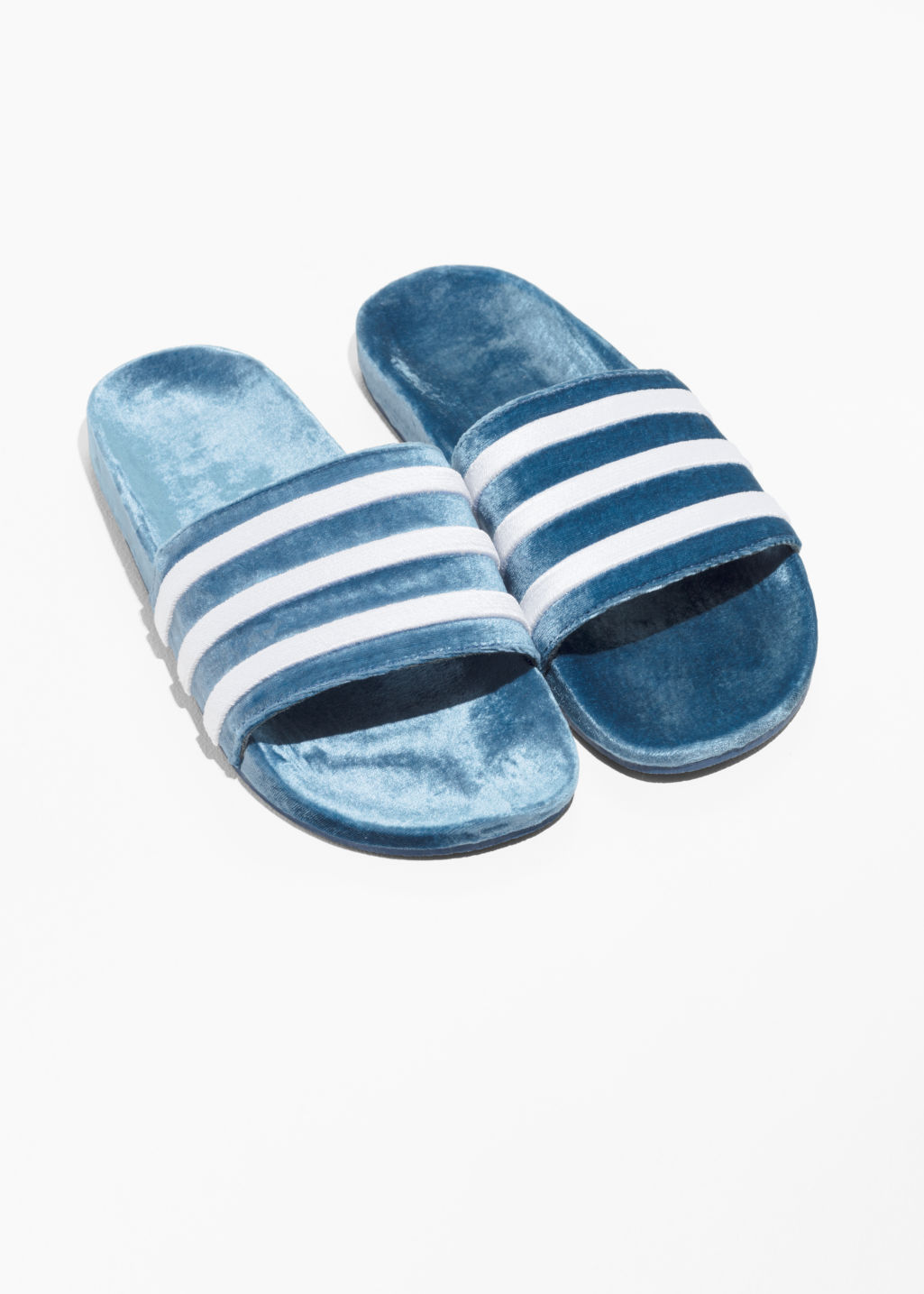 Back image of Stories adidas adilette slides in blue