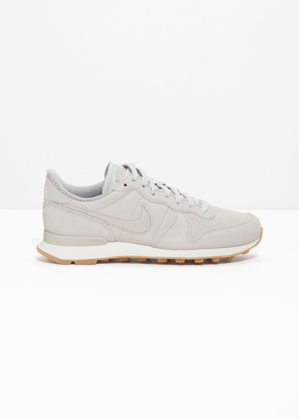 Front image of Stories nike internationalist  in grey