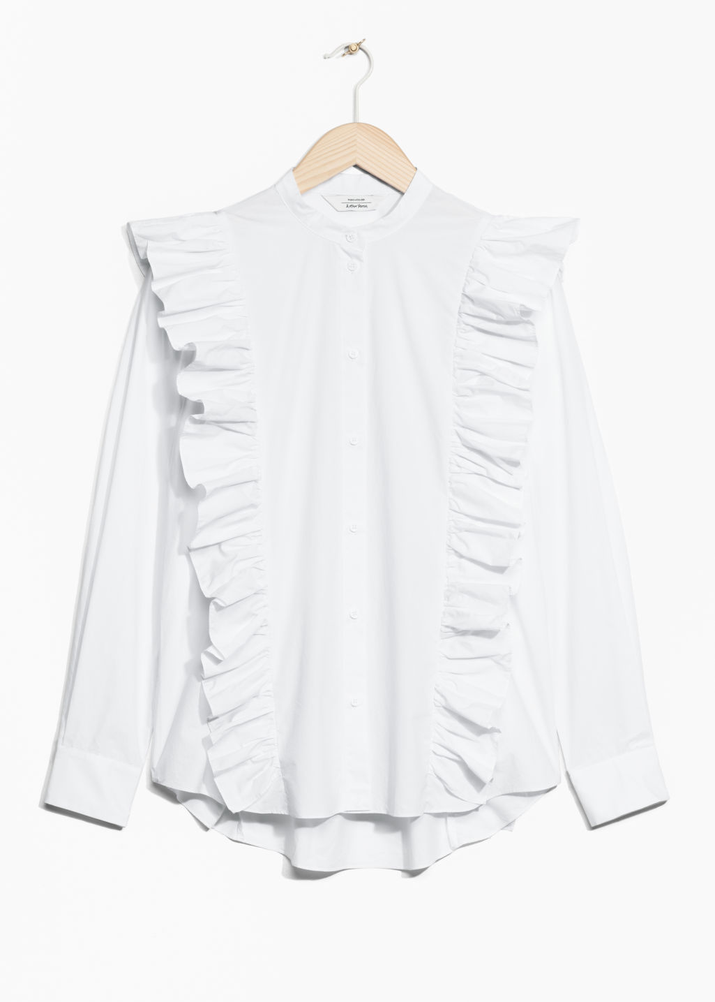 Front image of Stories frills blouse with button closure in white