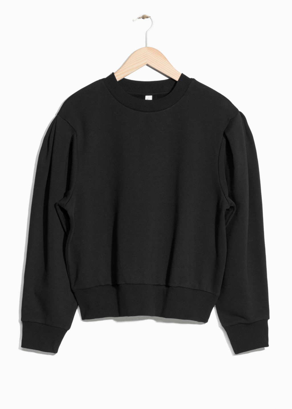 Front image of Stories puff sleeve cotton sweatshirt in black