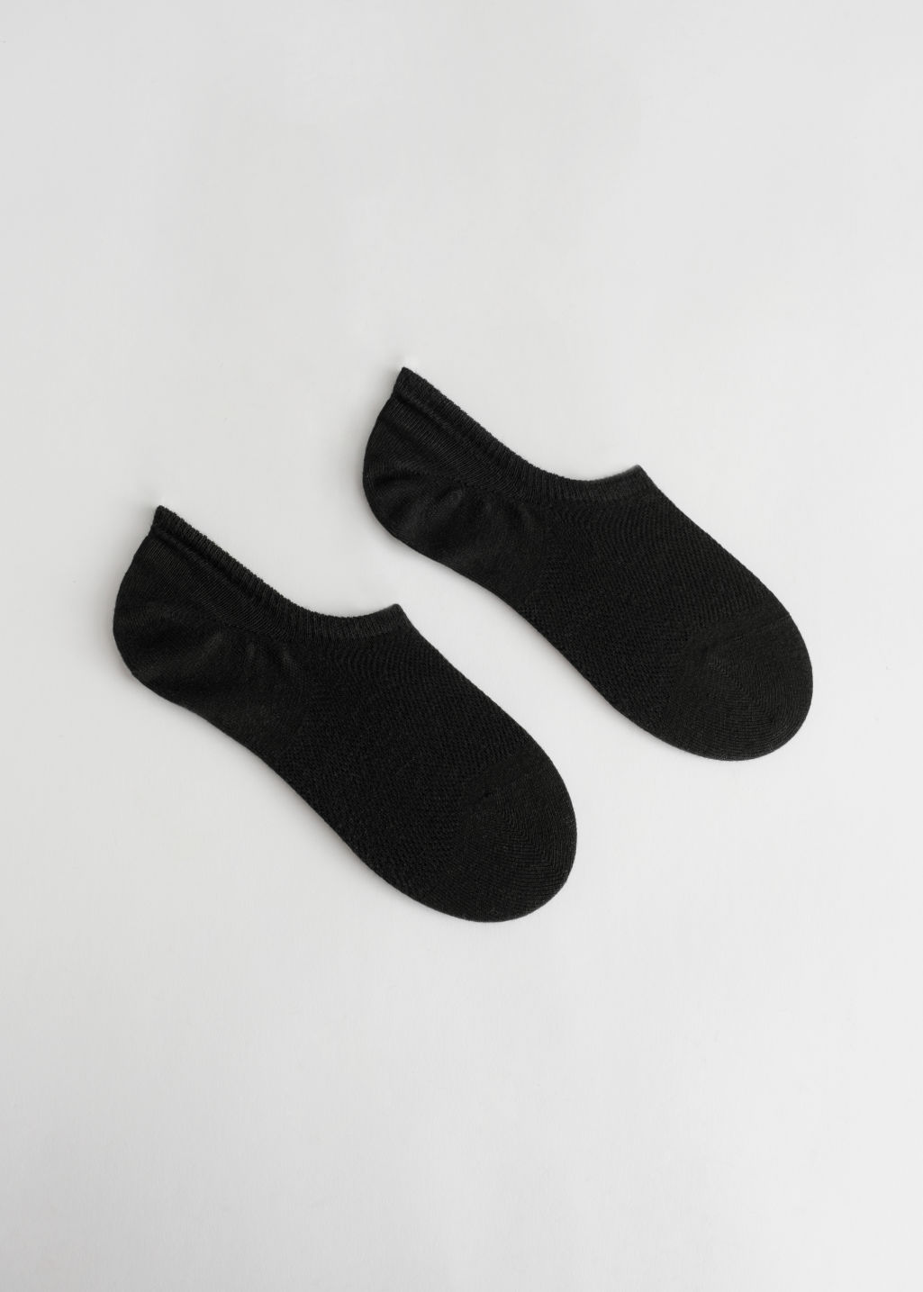 Front image of Stories arod sneakers socks in black