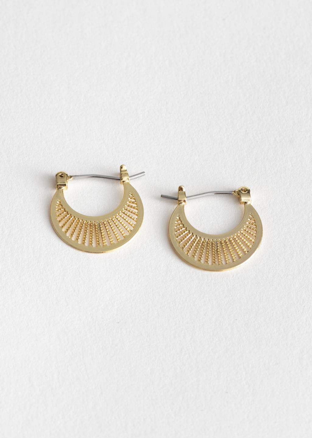 Front image of Stories ray hoop earrings in gold