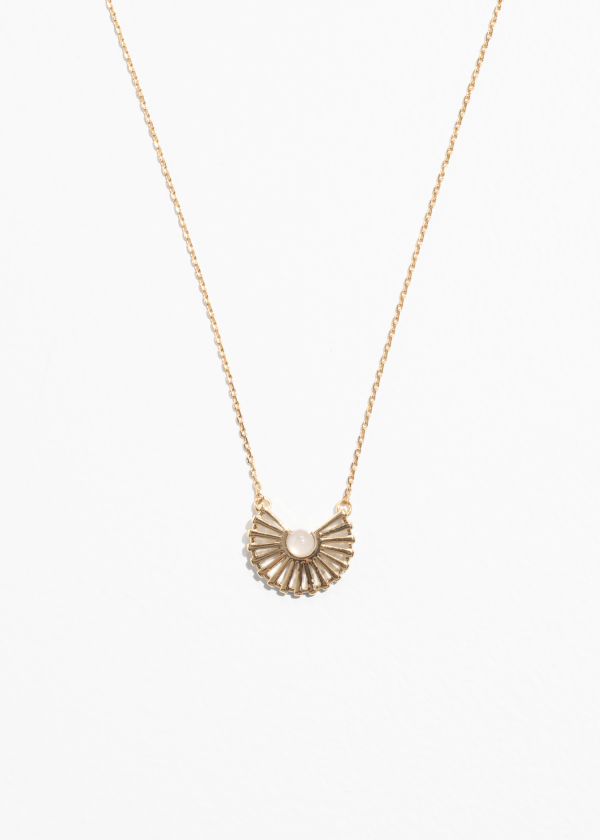 Front image of Stories sun fan necklace in white