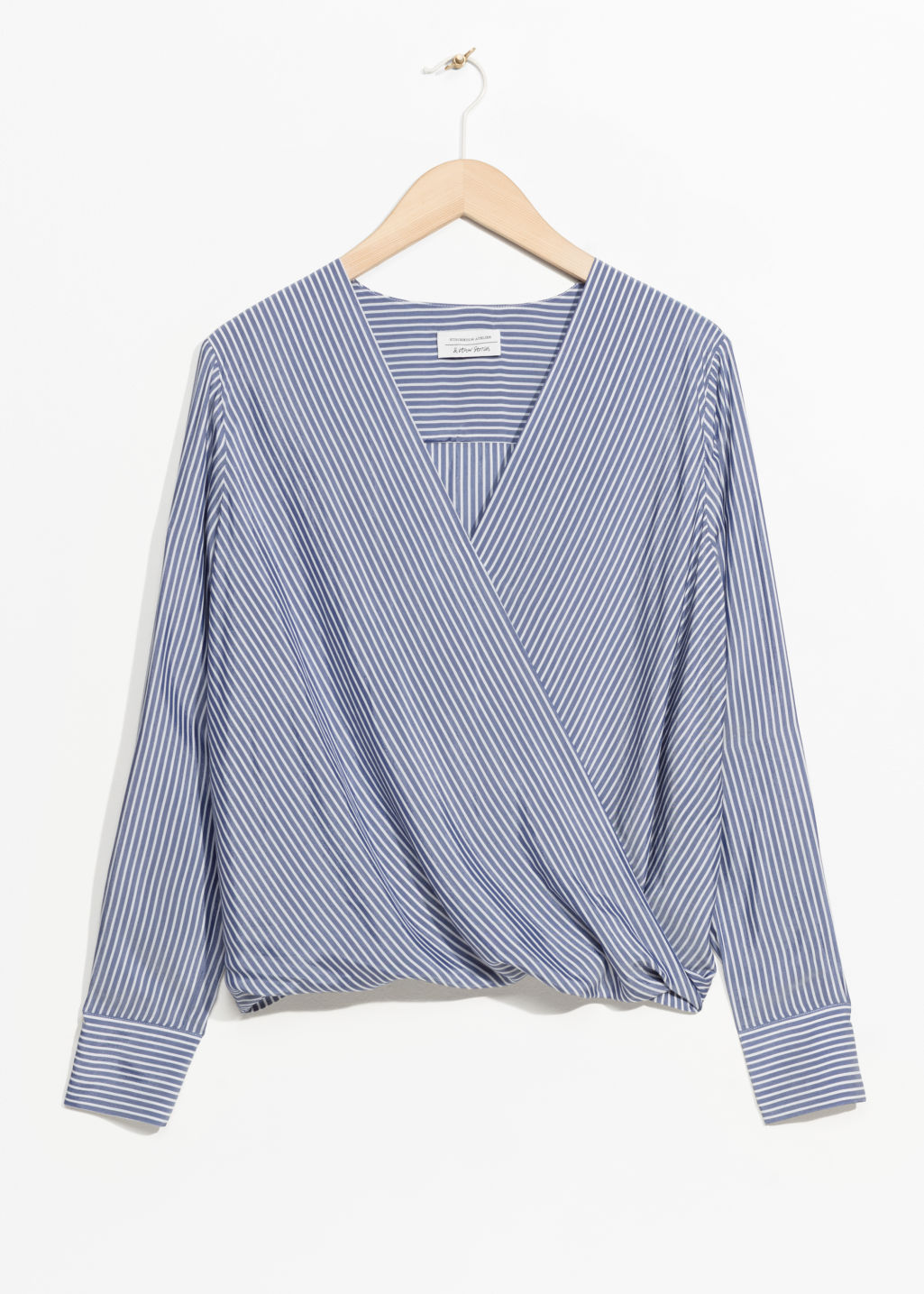 Front image of Stories wrap top in blue