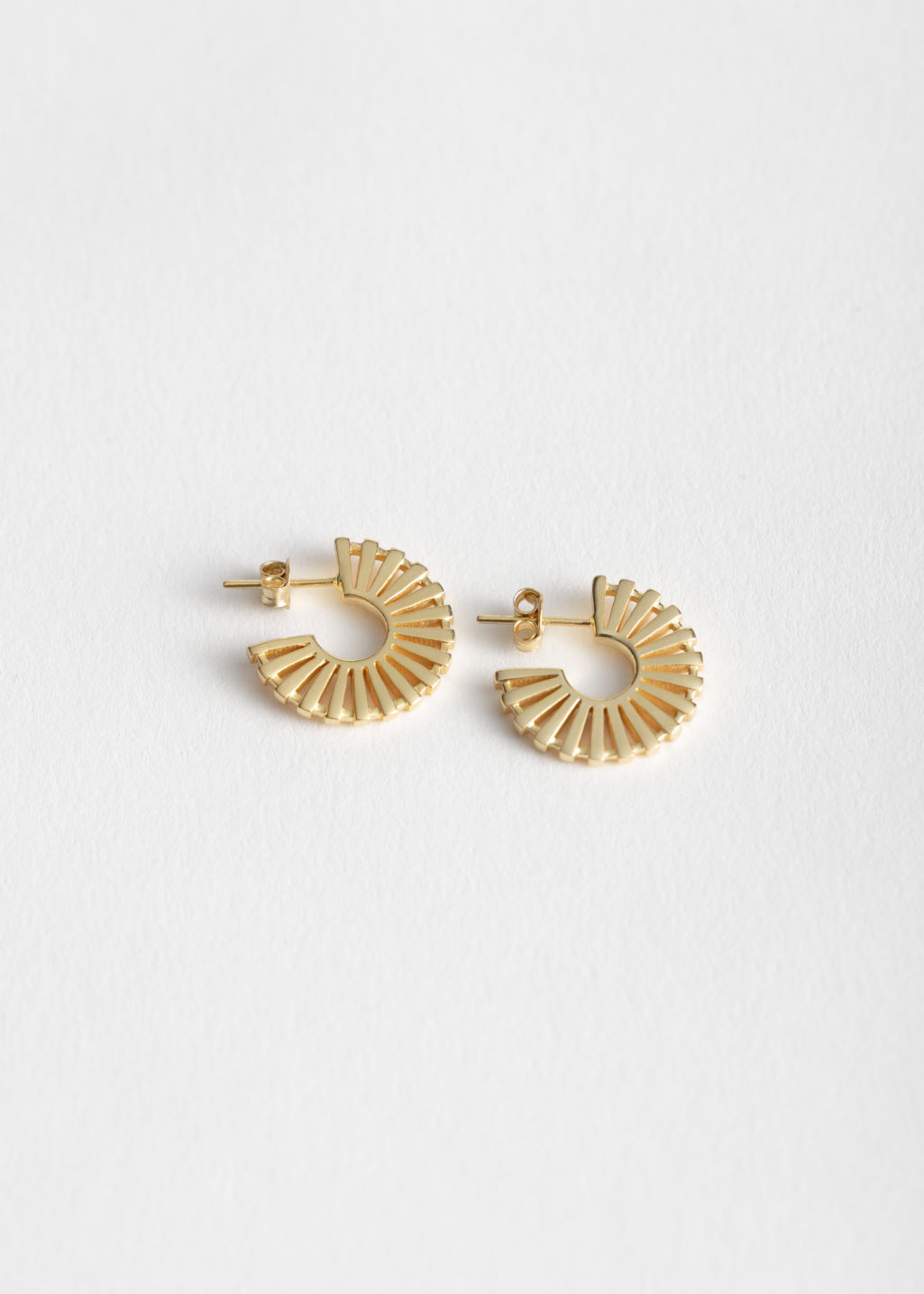 Front image of Stories sun fan earrings in gold