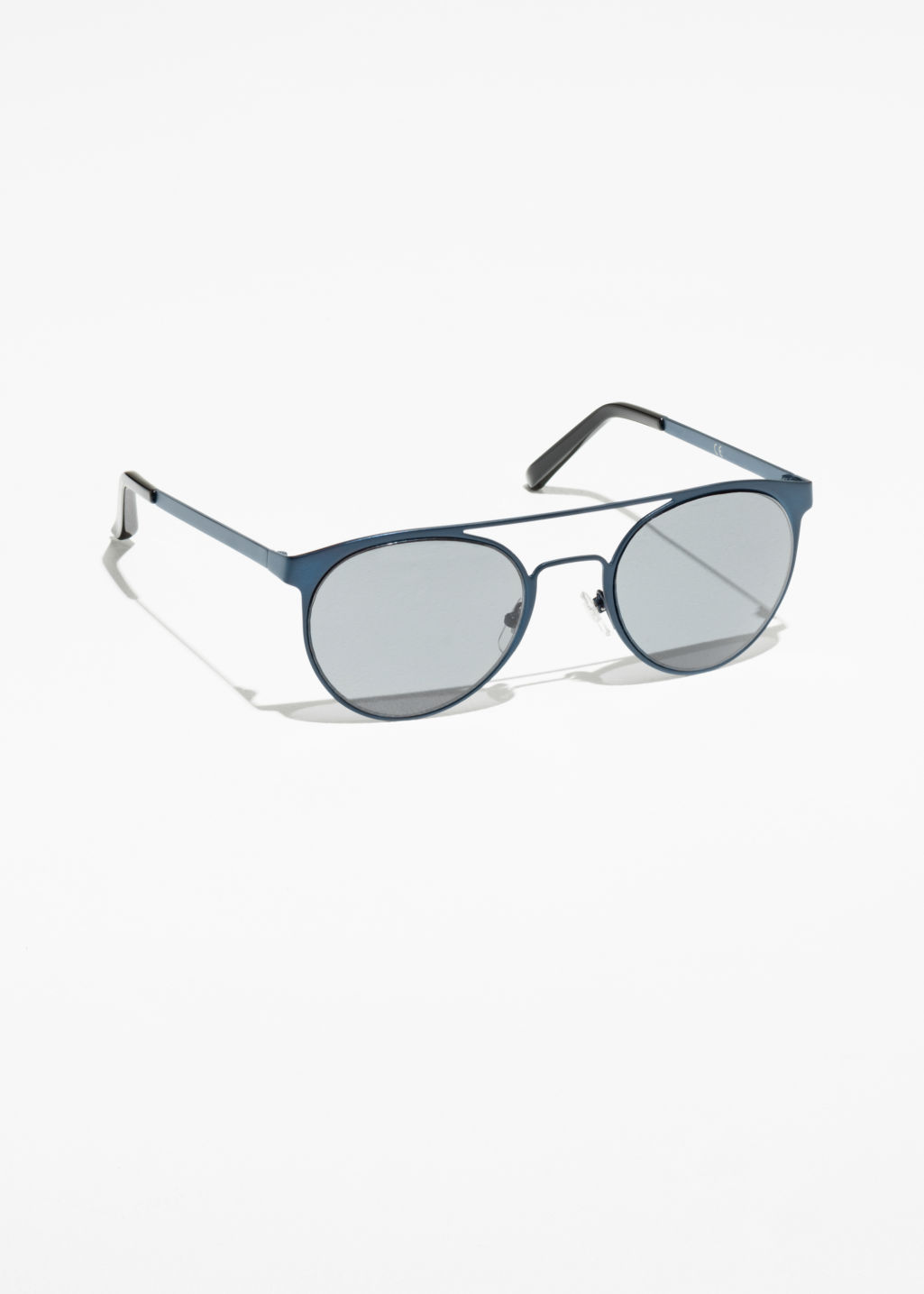 Front image of Stories metal frame shades in blue